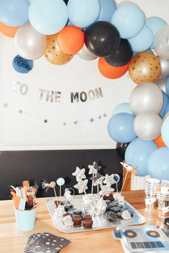 Space Themed Birthday Party | britstrawbridge.com | A Space Themed Birthday Party! A fun + easy space themed birthday party that's out of this world! With the help of Perfect Party In A Box, host the coolest themed party around with all the fixins'! This party will be just as fun to plan as it will be to hold! Space themed decorations, galaxy cookies, DIY moon piñata and more!